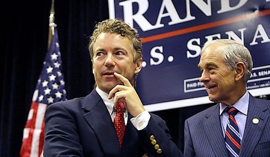 Ron Paul is campaigning for his son, Republican presidential hopeful Sen. Rand Paul, saying their mutual belief in liberty scares the media. (Associated Press) ** FILE **