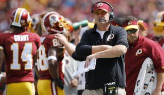 Washington Redskins head coach Jay Gruden watches the action from the sidelines during the first half of an NFL football game against the St. Louis Rams in Landover, Md., Sunday, Sept. 20, 2015. (AP Photo/Patrick Semansky)