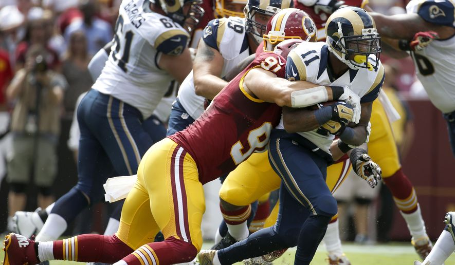 St. Louis Rams wide receiver Tavon Austin (11) carries the ball while being tackled by Washington Redskins outside linebacker Ryan Kerrigan (91) during the first half of an NFL football game in Landover, Md., Sunday, Sept. 20, 2015. (AP Photo/Alex Brandon)