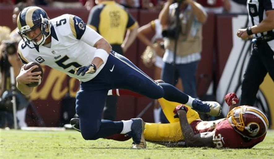 St. Louis Rams quarterback Nick Foles (5) is sacked by Washington Redskins free safety Dashon Goldson (38) during the second half of an NFL football game in Landover, Md., Sunday, Sept. 20, 2015. The Redskins defeated the Rams 24-10. (AP Photo/Alex Brandon)