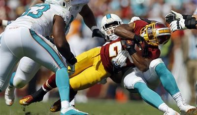 Washington Redskins running back Chris Thompson (25) is tackled by Miami Dolphins outside linebacker Koa Misi during the first half of an NFL football game Sunday, Sept. 13, 2015, in Landover, Md. (AP Photo/Patrick Semansky)