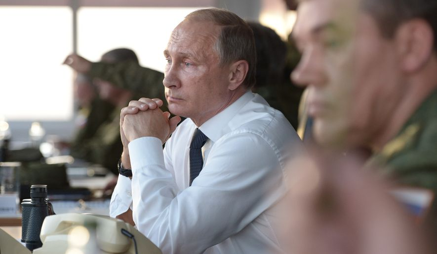 Russian President Vladimir Putin watches military exercises at Donguz range in Orenburg region, about 800 miles southeast of Moscow, on Saturday, Sept. 19, 2015. (Associated Press)