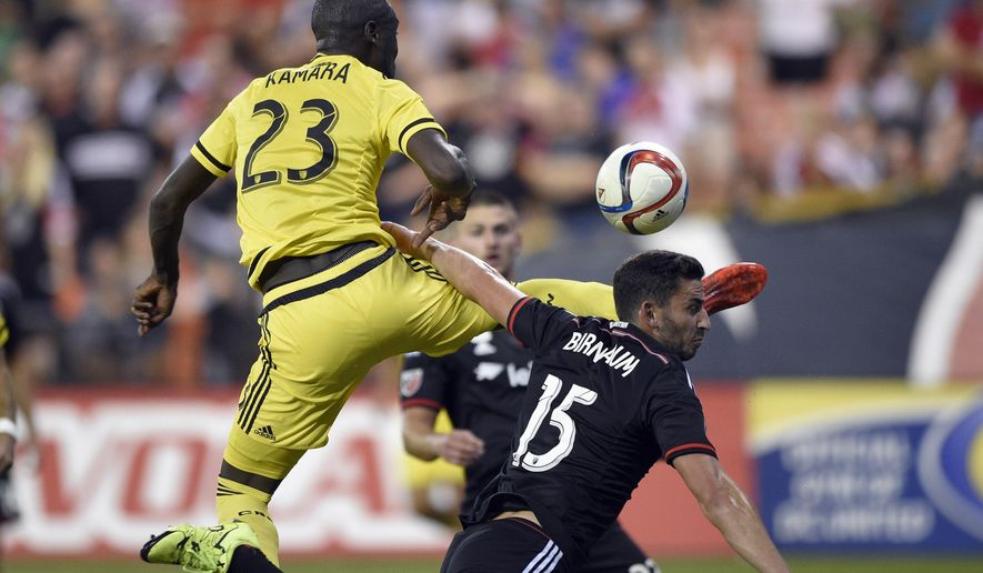 Columbus Crew forward Kei Kamara (23) battles for the ball against D.C. United defender Steve Birnbaum (15) during the second half of an MLS soccer game, Saturday, Sept. 19, 2015, in Washington. The Crew won 2-1. (AP Photo/Nick Wass)