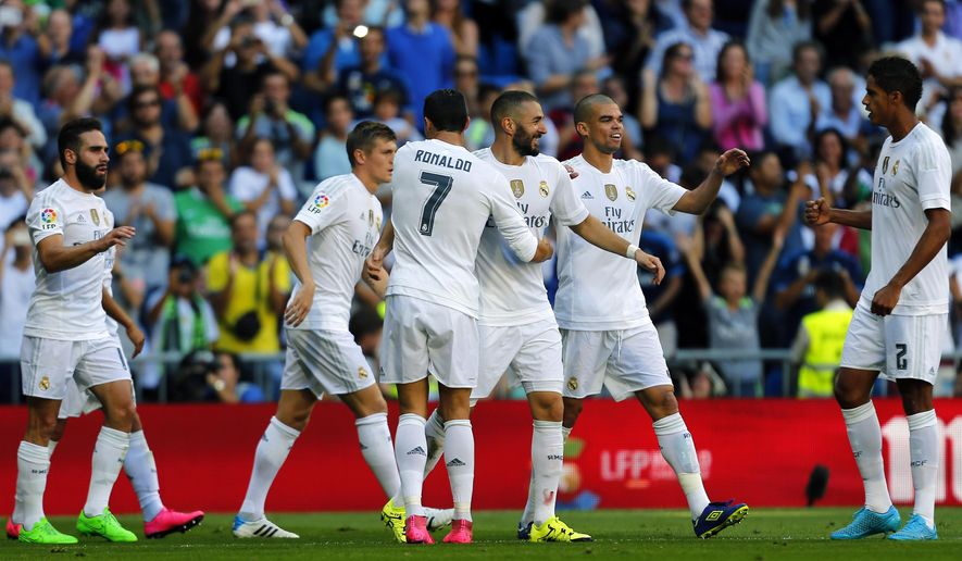 Real Madrid's Karim Benzema, third right, celebrates with teammates after scoring the opening goal against Granada during a Spanish La Liga soccer match between Real Madrid and Granada at the Santiago Bernabeu stadium in Madrid, Saturday, Sept. 19, 2015. Benzema scored once in Real Madrid's 1-0 victory. (AP Photo/Francisco Seco)