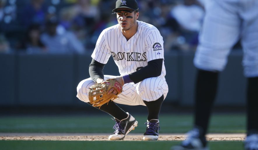 Colorado Rockies third baseman Nolan Arenado looks on in the eighth inning of a baseball game against the San Diego Padres, Sunday, Sept. 20, 2015, in Denver. San Diego won 10-4. (AP Photo/David Zalubowski)