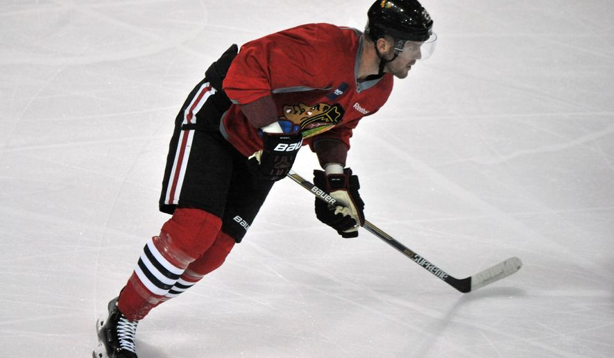 RETRANSMISSION TO CORRECT NAME TO BRYAN BICKELL FROM RYAN BICKELL - Chicago Blackhawks' Bryan Bickell skates during NHL hockey training camp at the Compton Family Ice Center on the campus of the University of Notre Dame in South Bend, Ind., Friday, Sept. 18, 2015. (AP Photo/Joe Raymond)