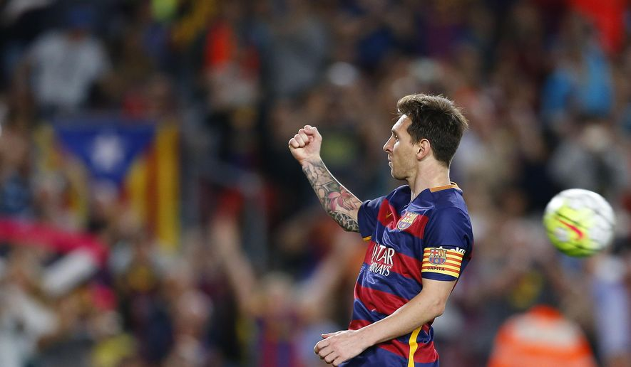 FC Barcelona's Lionel Messi celebrates after scoring during a Spanish La Liga soccer match against Levante at the Camp Nou stadium in Barcelona, Spain, Sunday, Sept. 20, 2015. (AP Photo/Manu Fernandez)