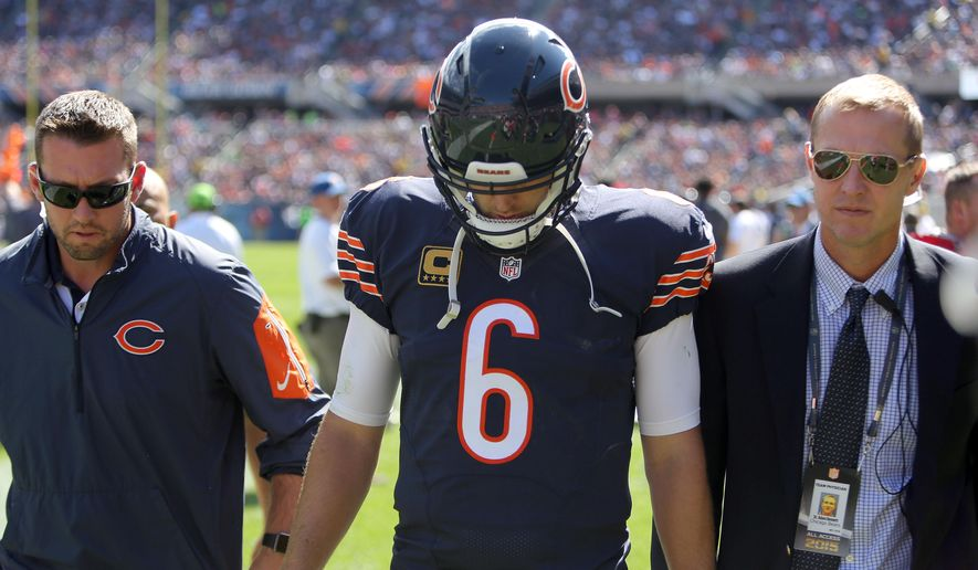 Chicago Bears quarterback Jay Cutler leaves the field getting injured during the second quarter of an NFL football game against the Arizona Cardinals, Sunday, Sept. 20, 2015 in Chicago. (Steve Lundy/Daily Herald via AP) MANDATORY CREDIT; MAGS OUT