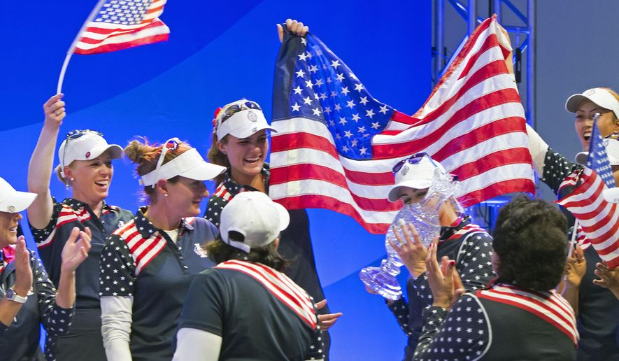 United States Alison Lee kisses the trophy during the award ceremony at the Solheim Cup golf tournament in St. Leon-Rot, southern Germany, Sunday, Sept. 20, 2015. USA won the competition. (AP Photo/Jens Meyer)