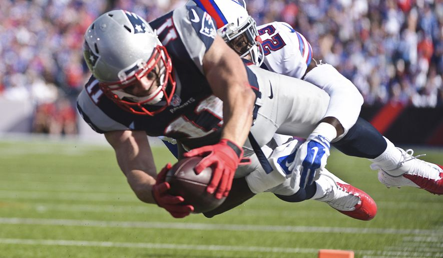 New England Patriots wide receiver Julian Edelman (11) dives past Buffalo Bills free safety Aaron Williams (23) for a touchdown during the second half of an NFL football game Sunday, Sept. 20, 2015, in Orchard Park, N.Y. (AP Photo/Gary Wiepert)