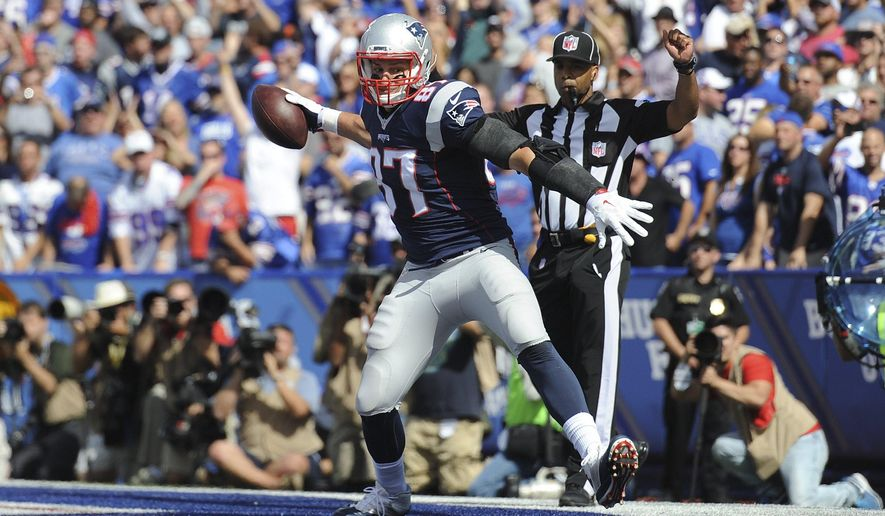 New England Patriots tight end Rob Gronkowski (87) celebrates after scoring a touchdown during the first half of an NFL football game against the Buffalo Bills, Sunday, Sept. 20, 2015, in Orchard Park, N.Y. (AP Photo/Gary Wiepert)