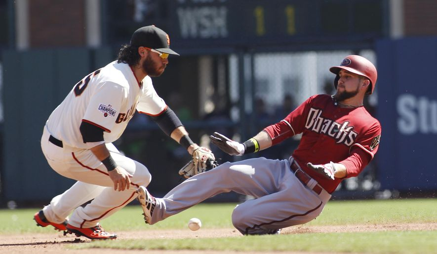 Arizona Diamondbacks' Ender Inciarte, right, slides safely into second base with a double as San Francisco Giants' Brandon Crawford covers during the fourth inning of a baseball game, Sunday, Sept. 20, 2015, in San Francisco. The Giants won 5-1. (AP Photo/George Nikitin)