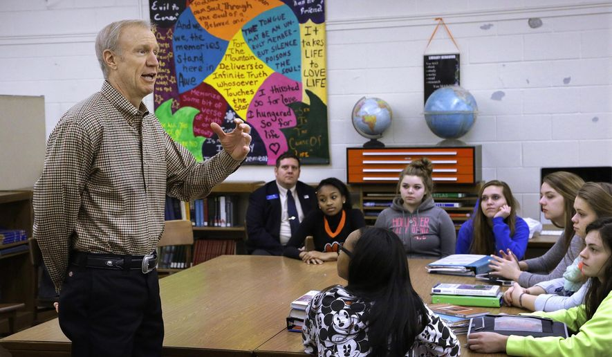 In this Tuesday, Feb. 10, 2015, photo, Illinois Gov. Bruce Rauner speaks to students during a visit to a school in Springfield, Ill. Illinois school districts are trying again to get relief from a series of unfunded mandates they say are driving up costs and sometimes forcing them to layoff reading instructors to hire physician education teachers. This time they may have a powerful ally in Rauner, who has proposed eliminating some of the mandates as part of a larger state budget deal. (AP Photo/Seth Perlman)