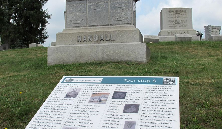 "In this Aug. 31, 2015, photo, one of 20 tour stops along the new ""cemetrail"" at Cortland Rural Cemetery in Cortland, N.Y., is shown. Funded by a $30,000 grant, new signs tell visitors about the people buried there, geology of the rock used for markers and the trees that shade them. The project comes as cemeteries, hurt financially by the trend toward cremations, look for innovative ways to make up for lost revenue. (AP Photo/Carolyn Thompson)"