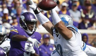 Detroit Lions defensive tackle Haloti Ngata (92) deflects a Minnesota Vikings quarterback Teddy Bridgewater (5) pass-attempt in the first half of an NFL football game in Minneapolis, Sunday, Sept. 20, 2015. (AP Photo/Jim Mone)