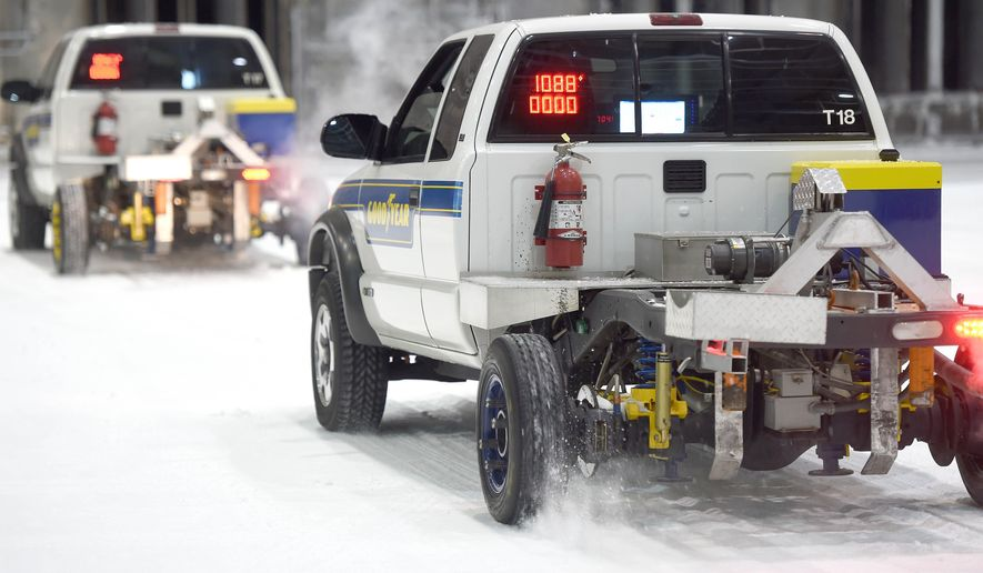 In this Sept. 1, 2015, photo, Goodyear technicians drive trucks outfitted with standard reference test tires in snowy conditions inside the McKinley Climatic Lab on Eglin Air Force Base in Fort Walton Beach, Fla. The McKinley Climate Lab can simulate almost any weather condition, from temperatures of -60 to 160 degrees. (Nick Tomecek/Northwest Florida Daily News via AP) MANDATORY CREDIT