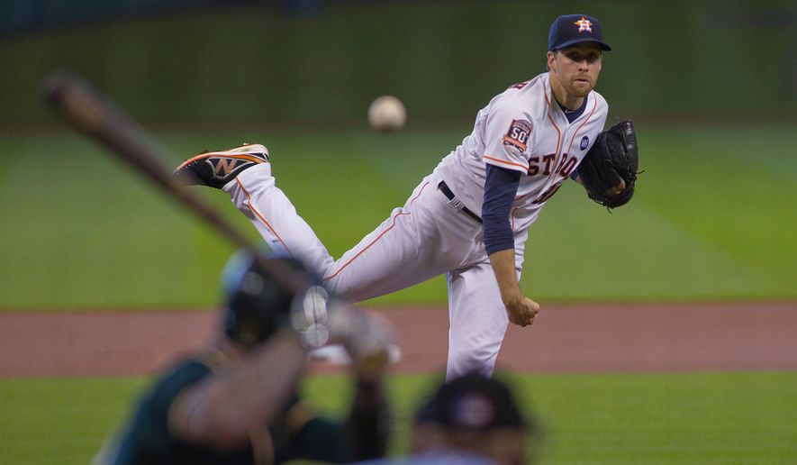 Houston Astros pitcher Collin McHugh delivers a pitch to Oakland Athletics' Brett Lawrie in the first inning of a baseball game Sunday, Sept. 20, 2015, in Houston.  (AP Photo/Richard Carson)