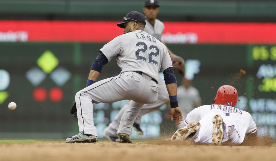 Texas Rangers Elvis Andrus (1) steals second base against Seattle Mariners second baseman Robinson Cano (22) during the fourth inning of a baseball game in Arlington, Texas, Sunday, Sept. 20, 2015.(AP Photo/LM Otero)