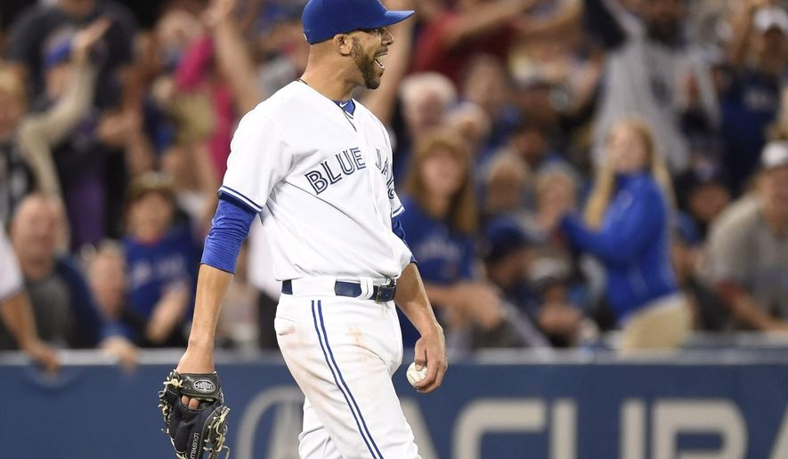 Toronto Blue Jays' starting pitcher David Price struts backwards after catching a pop fly from New York Yankees' catcher Brian McCann during sixth inning baseball action in Toronto, Monday, Sept. 21, 2015. (Frank Gunn/The Canadian Press via AP) MANDATORY CREDIT