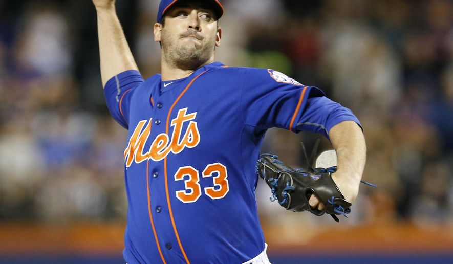New York Mets starting pitcher Matt Harvey delivers in the first inning of a baseball game against the New York Yankees in New York, Sunday, Sept. 20, 2015. (AP Photo/Kathy Willens)
