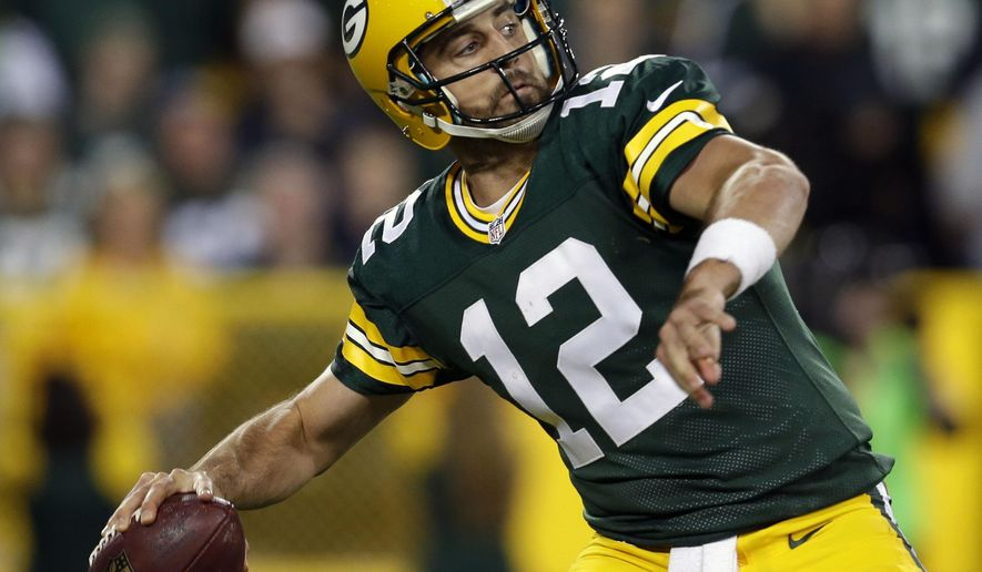 Green Bay Packers' Aaron Rodgers throws long against the Seattle Seahawks during the first half of an NFL football game, Sunday, Sept. 20, 2015 at Lambeau Field in Green Bay, Wis. (Wm. Glasheen/The Post-Crescent via AP) NO SALES