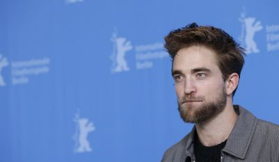 "A Monday, Feb. 9, 2015, photo from files of actor Robert Pattinson during the photo call for the movie ""Life"" at the 2015 Berlinale Film Festival in Berlin. The man relentlessly pursued by photographers is stepping into their shoes for his latest movie role. British heartthrob Robert Pattinson plays photographer Dennis Stock. (AP Photo/Michael Sohn, File)"