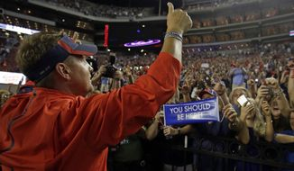 Mississippi head coach Hugh Freeze celebrates with fans after they defeated Alabama 43-37 after an NCAA college football game, Sunday, Sept. 20, 2015, in Tuscaloosa, Ala. (AP Photo/Butch Dill)