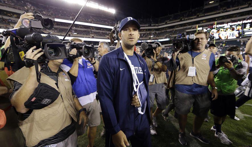 Injured Dallas Cowboys quarterback Tony Romo walks the field after an NFL football game against the Philadelphia Eagles, Sunday, Sept. 20, 2015, in Philadelphia. Dallas won 20-10. (AP Photo/Matt Rourke)