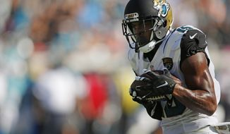 FILE - In this Sept. 20, 2015 file photo, Jacksonville Jaguars wide receiver Allen Robinson (15) makes the catch against the Miami Dolphins during the first half of an NFL football game in Jacksonville, Fla. Robinson scored a touchdown on the play. The  Jaguars believe they have a legitimate, No. 1 receiver, the franchise's first in nearly a decade. In a win against Miami on Sunday, second-year pro Robinson showed outsiders what teammates, coaches and a few others have been witnessing for months(AP Photo/Stephen B. Morton)