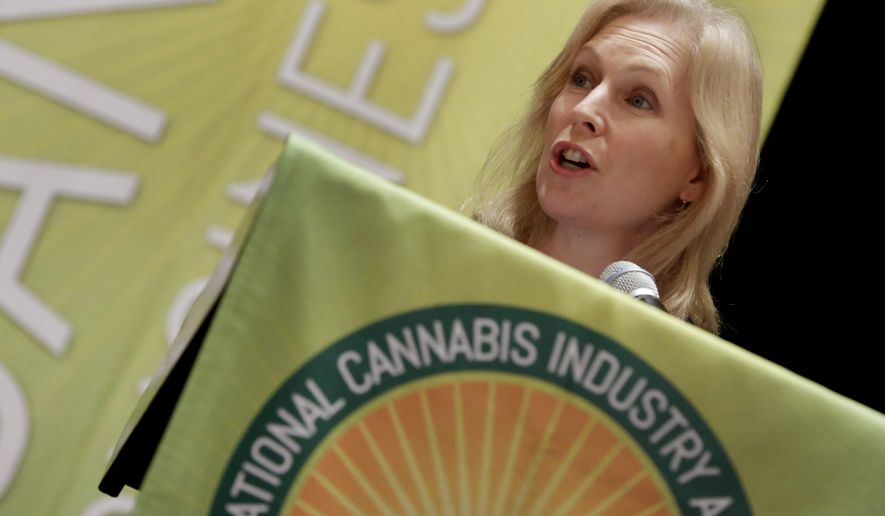 U.S. Sen. Kirsten Gillibrand, D-NY, addresses the National Cannabis Industry Association meeting, in New York,  Monday, Sept. 21, 2015. The meeting  was for people in the pot business seeking to develop best practices for medical marijuana. (AP Photo/Richard Drew)