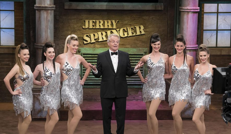 "This Aug. 24, 2015, file photo provided by NBC shows host Jerry Springer, center, during taping of the 25th anniversary episode of ""The Jerry Springer Show,"" in Stamford, Conn. (Virginia Sherwood/NBC via AP)"
