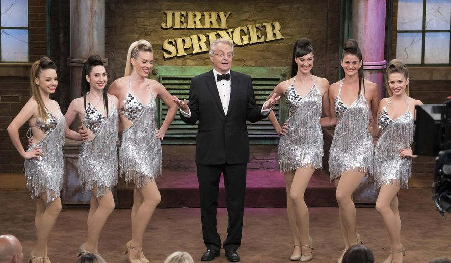 "This Aug. 24, 2015 photo provided by NBC shows host Jerry Springer, center, during taping of the 25th anniversary episode of ""The Jerry Springer Show,"" in Stamford, Conn. (Virginia Sherwood/NBC via AP)"