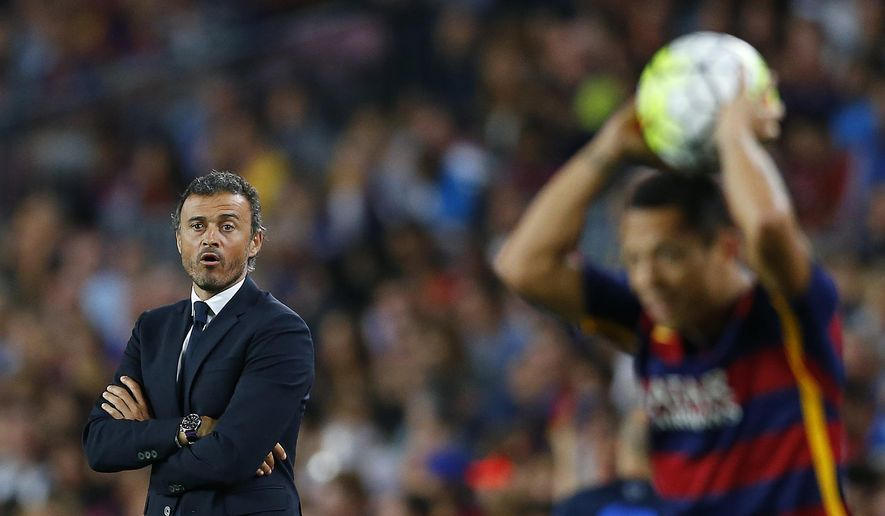 FC Barcelona's head coach Luis Enrique looks on during a Spanish La Liga soccer match against Levante at the Camp Nou stadium in Barcelona, Spain, Sunday, Sept. 20, 2015. (AP Photo/Manu Fernandez)