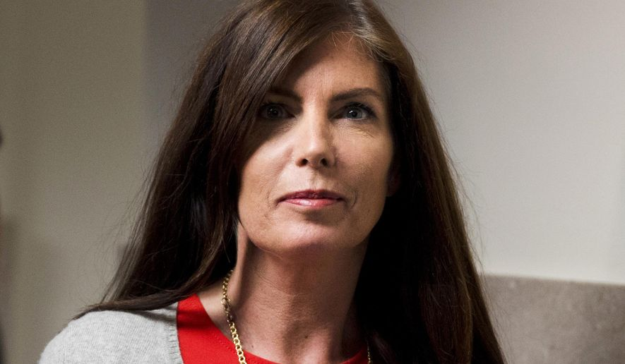 FILE - In this Aug. 24, 2015 file photo, Pennsylvania Attorney General Kathleen Kane departs after her preliminary hearing at the Montgomery County courthouse in Norristown, Pa.  The state's highest court on Monday, Sept, 21, 2015, ordered the temporary suspension of Kane's law license, a step that could trigger a Senate vote to remove her as she faces criminal charges. (AP Photo/Matt Rourke, File)