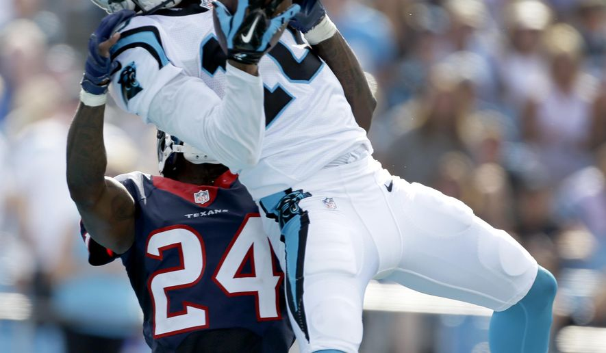 Carolina Panthers' Corey Brown (10) catches a touchdown pass as Houston Texans' Johnathan Joseph (24) defends during the second half of an NFL football game in Charlotte, N.C., Sunday, Sept. 20, 2015. (AP Photo/Bob Leverone)