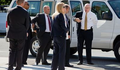 Director Joseph Clancy (right) and other members of the Secret Service visit the Basilica of the National Shrine of the Immaculate Conception in Washington as preparations are finalized for Pope Francis to lead a canonization Mass. (AP Photo)