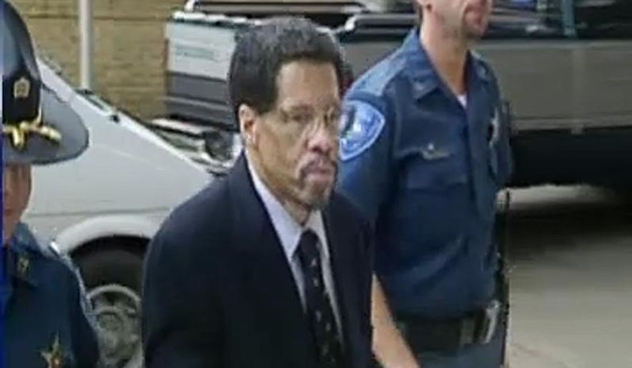 FILE- In this Feb 12, 2015 file image made from video and released by WBRZ-TV in Baton Rouge, Albert Woodfox walks into a courthouse in Louisiana. The last member of the Angola Three still in prison was set to appear in a Louisiana court Monday, Sept. 21, 2015,  for a hearing on various motions ahead of his third trial for allegedly killing a prison guard. Lawyers for Albert Woodfox are pushing for his indictment in the 1972 death to be thrown out, for the trial to be moved to a new location and for key witness testimony to be barred. The state says the trial should go forward. (WBRZ-TV via AP, File)