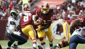 Washington Redskins running back Matt Jones (31) carries the ball during the first half of an NFL football game against the St. Louis Rams in Landover, Md., Sunday, Sept. 20, 2015. (AP Photo/Alex Brandon)