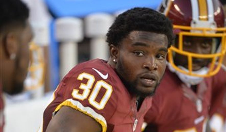 Washington Redskins strong safety Kyshoen Jarrett sits on the bench during an NFL preseason football game against the Cleveland Browns Thursday, Aug. 13, 2015, in Cleveland. Washington won 20-17. (AP Photo/David Richard)