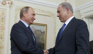 Russian President Vladimir Putin shakes hands with Israeli Prime Minister Benjamin Netanyahu, right, during their meeting in the Novo-Ogaryovo residence, outside Moscow, Russia, Monday, Sept. 21, 2015. (AP Photo/Ivan Sekretarev, Pool) **FILE**