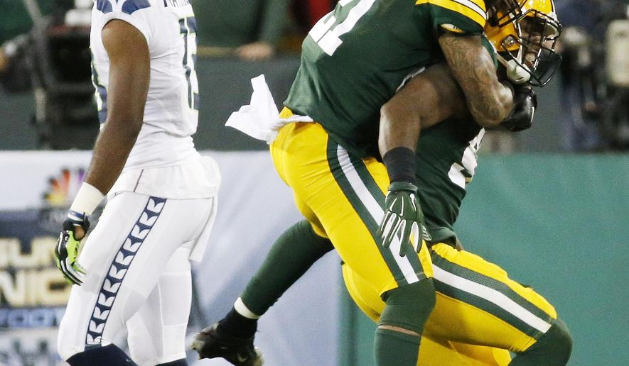 Green Bay Packers' Ha Ha Clinton-Dix (21) celebrates with Jayrone Elliott in front of Seattle Seahawks' Chris Matthews during the second half of an NFL football game Sunday, Sept. 20, 2015, in Green Bay, Wis. The Packers won 27-17. (AP Photo/Mike Roemer)
