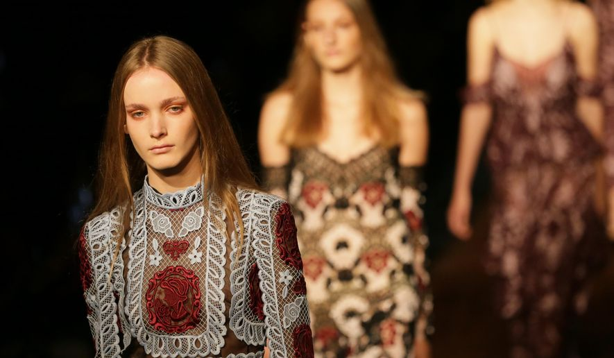 Models wear outfits by designer Erdem during the Spring/Summer 2016 show for London Fashion Week at the King's Cross Theatre, in London, Monday Sept. 21, 2015. (AP Photo/Tim Ireland)