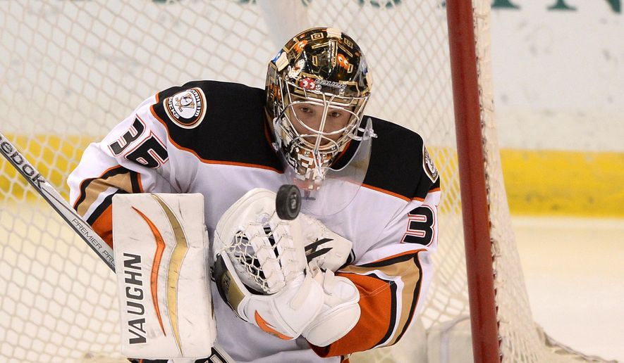 FILE - In this Oct. 20, 2014 file photo, Anaheim Ducks goalie John Gibson (36) blocks a shot against the St. Louis Blues in an NHL hockey game in St. Louis. The Ducks announced Monday, Sept. 21, 2015 that Gibson has agreed to a three-year, $6.9 million contract extension with the Anaheim Ducks. The 22-year-old Gibson is considered one of the top young goalies in hockey, and he has won 16 NHL games over the past two seasons with the Ducks. (AP Photo/Bill Boyce, File)