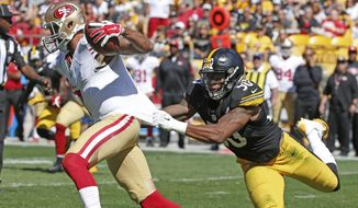 Pittsburgh Steelers inside linebacker Ryan Shazier (50) grabs San Francisco 49ers quarterback Colin Kaepernick (7) by the jersey as he scrambles in the fourth quarter of an NFL football game, Sunday, Sept. 20, 2015, in Pittsburgh. Kaepernick got loose but was tackled down field. (AP Photo/Gene J. Puskar)