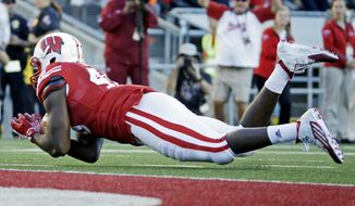 Wisconsin's Austin Traylor catches a 38-yard pass during the second half of an NCAA college football game against Troy, Saturday, Sept. 19, 2015, in Madison, Wis. (AP Photo/Morry Gash)