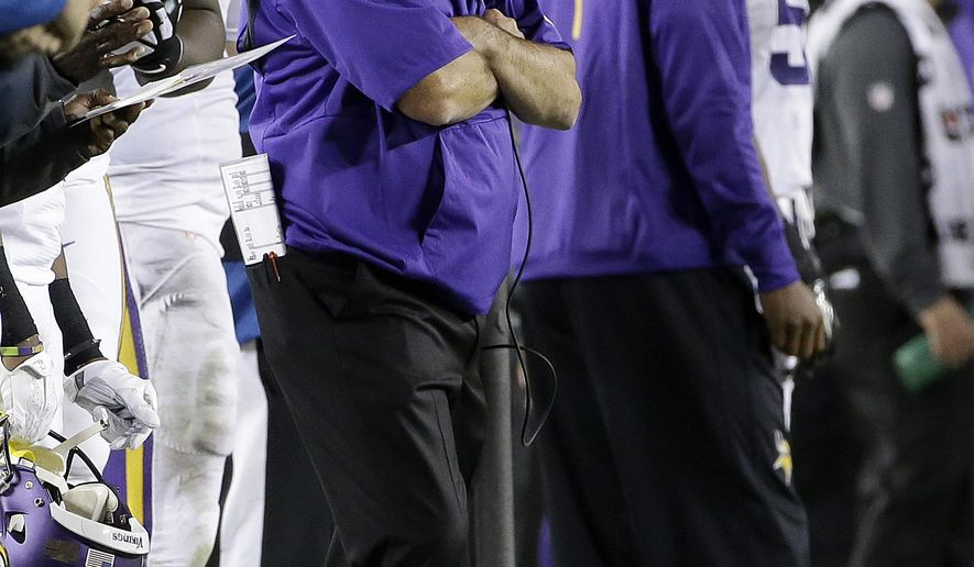Minnesota Vikings head coach Mike Zimmer watches during the second half of an NFL football game against the San Francisco 49ers in Santa Clara, Calif., Monday, Sept. 14, 2015. The 49ers won 20-3. (AP Photo/Marcio Jose Sanchez)