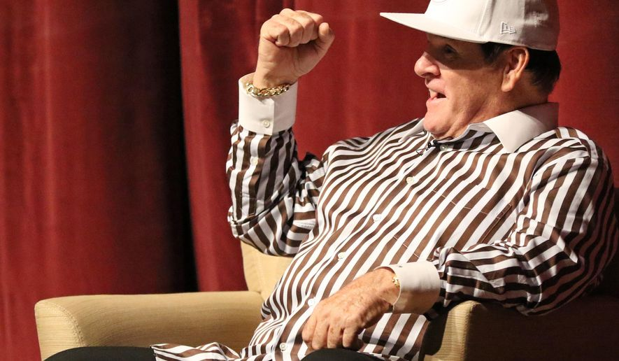 Former Cincinnati Reds player and manager Pete Rose pumps his fist during a lecture on ethics in sport on the campus of Miami University, Monday, Sept. 21, 2015, in Oxford, Ohio. (AP Photo/Gary Landers)