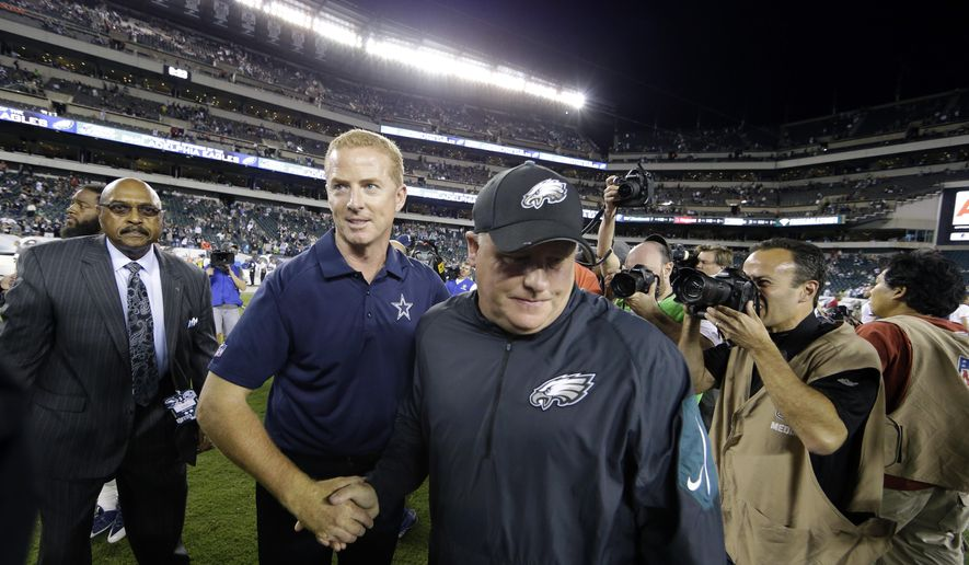 Dallas Cowboys head coach Jason Garrett, left, greets Philadelphia Eagles head coach Chip Kelly after an NFL football game, Sunday, Sept. 20, 2015, in Philadelphia. Dallas won 20-10. (AP Photo/Matt Rourke)