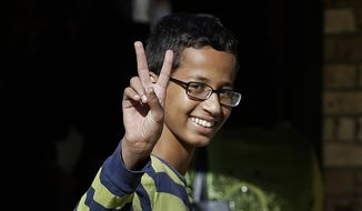 Ahmed Mohamed gestures as he arrives to his family's home in Irving, Texas, in this Sept. 17, 2015, file photo. (AP Photo/LM Otero, File)