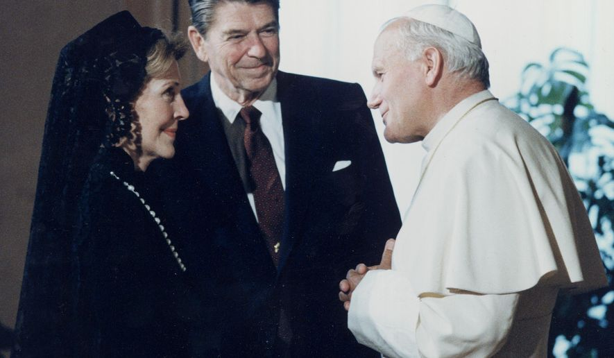 In this June 7, 1982 photo, U.S. President Ronald Reagan and his wife, first lady, Nancy Reagan, meet Pope John Paul II at the Vatican. (AP Photo/File)